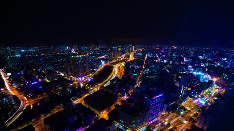 A night timelapse of cityscape in Ho Chi Minh high angle wide shot tilt Live Action