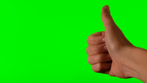 Hand with thumb up on a green background Live Action