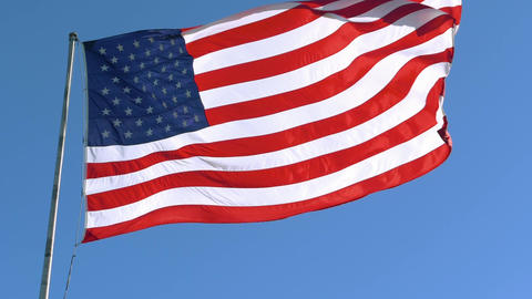 Closeup of an American flag flying in the wind Live Action