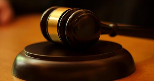 Judge Banging Gavel in Courtroom Live Action