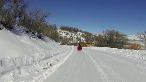 Winter recreation sled riding rural road HD 006 Footage