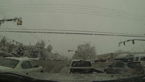 Winter snow storm POV vehicle at urban traffic light HD 0212 Footage