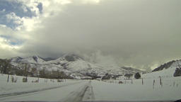 Winter snowy and cloudy day mountain road HD 0122 Footage