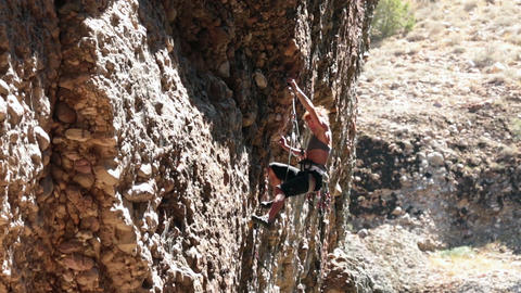 Woman climbs rock face Maple Box Canyon Utah HD 2716 Footage