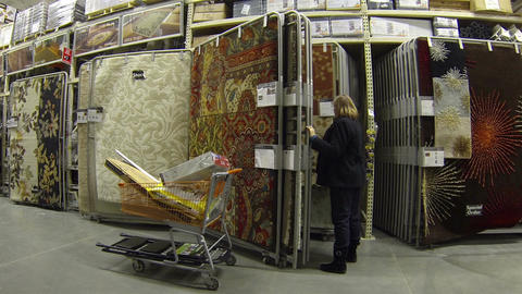 Woman shops for home rugs in department store HD 017 Footage