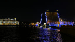 Palace Bridge drawn up at night time, blue illumination for touristic attraction Live Action