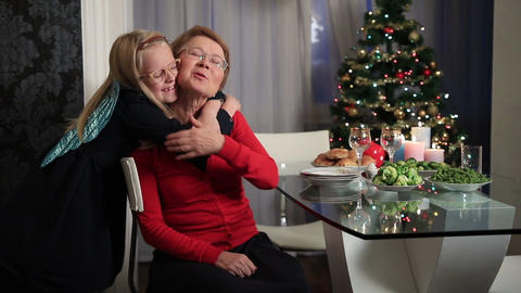 Little girl hugging her grandmother on Christmas Footage