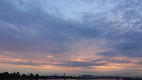 Soft colored skies at sunset, tender sun rays shine behind clouds, timelapse Filmmaterial