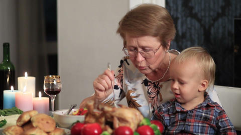 Loving grandmother feeding her grandson Footage