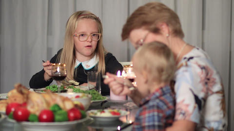 Family enjoying meal together on holidays Live Action