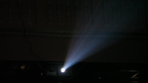 Bright video projector beam in dusty air, dark room, ray change brightness Footage