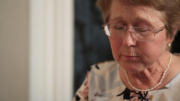 Senior woman eating homemade food Footage