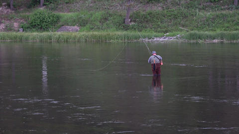 Yellowstone fly fisherman getting ready in river 4K Footage