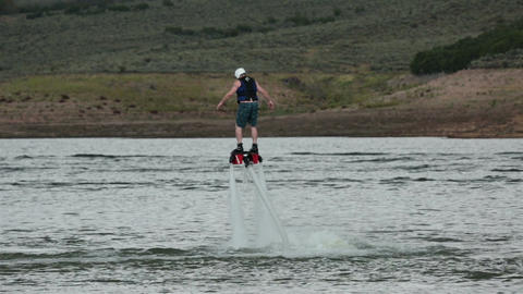Young Man Fly Board flying summer vacation lake HD 9540 Footage