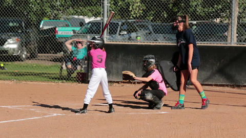 Young girl community softball game swing HD 3230 Footage