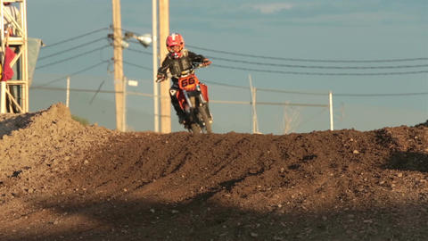 Youth motocross motorcycle race corner hill HD 8321 Stock Video Footage