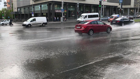 flow of cars along the street of the city in bad weather with heavy rain and Live Action