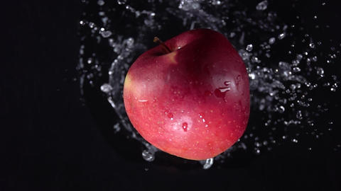Apple with water. Slow motion 500 fps Live Action