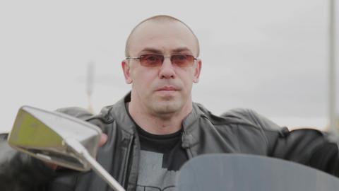 Male biker on a motorcycle GIF