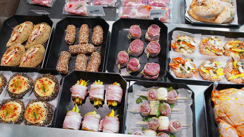 Appetizing meat products are on display in special containers. Meat products for Live Action