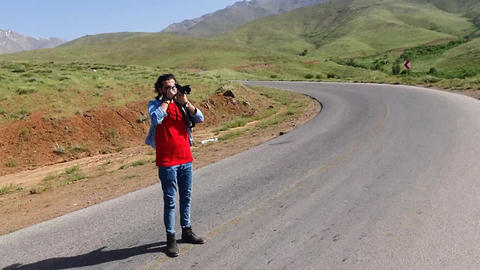 Man Photography in the mountain and road Live Action