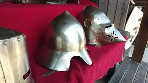 Two knight's helmets in the castle Live Action
