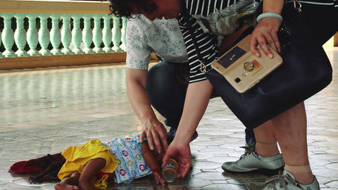 Sleeping Child On A Floor Of The Royal Palace In The Phnom Penh, Cambodia, Asia Live Action