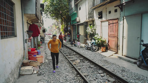 Hanoi Train Street through slums Live Action