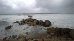 Ocean waves on rocky shore, slow motion Live Action