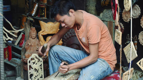 Wood carving made by a guy in Hoi An Vietnam Live Action
