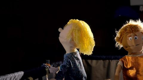 Puppet theatre: dolls hiding under the scenes Live Action