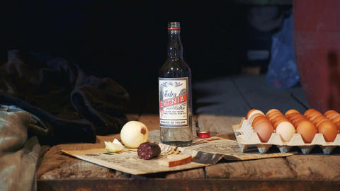 Exhibit of old peasant table with vodka, sausage, onion, eggs and other things Live Action