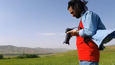 Man photography on a green farm Live Action