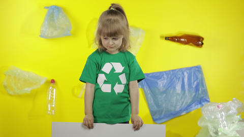 Girl activist holding poster Love Your Mother Earth. Plastic nature pollution Live Action