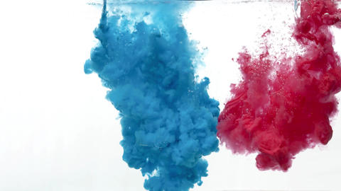 Two colors of paint dripping and dissolving in water, Live Action