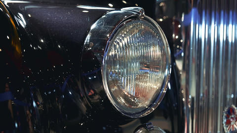 Close-up of headlight of black vintage car Live Action