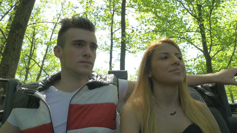 Beautiful teenage couple enjoying nature in a convertible car Footage