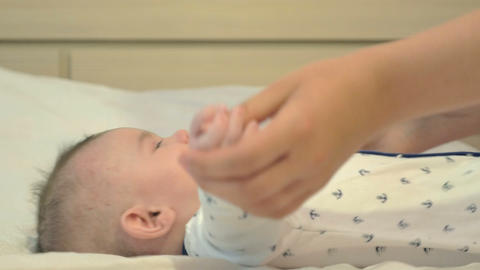 Adorable newborn boy playing with his mother Footage