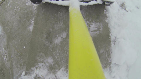 snow shovel on home sidewalk point of view HD 003 Live Action