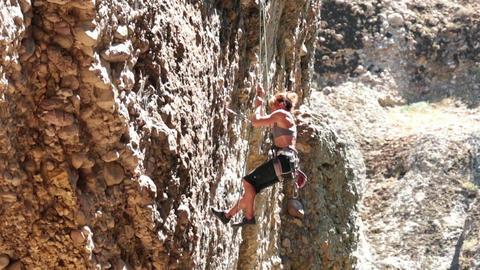 Woman climbing overhang rock mountain Maple Canyon HD 2717 Footage