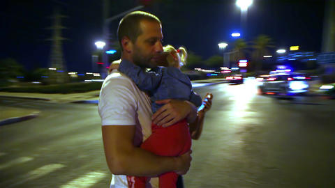 Young family walking on a pedestrian crossing in the evening Footage