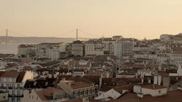 Pan shot of Lisbon cityscape with bridge during daytime Footage