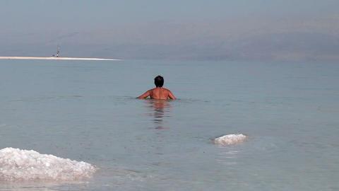 Woman bathing in the Dead Sea Footage