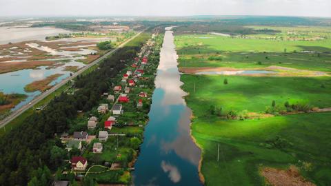 drone flies above township on riverside ライブ動画