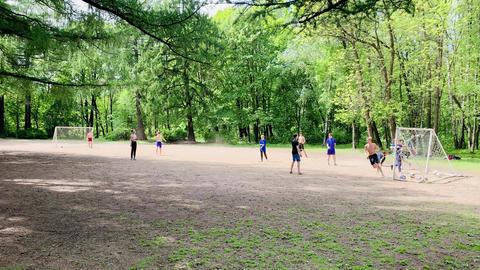 Russia, St.Petersburg, 03 June 2020: Teenagers play football on a football field Acción en vivo