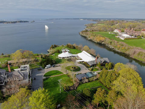 Aerial view of wedding reception ceremony setup with big white tents next the Photo