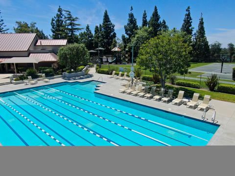 Aerial view of recreational facilities with pools in private residential Photo