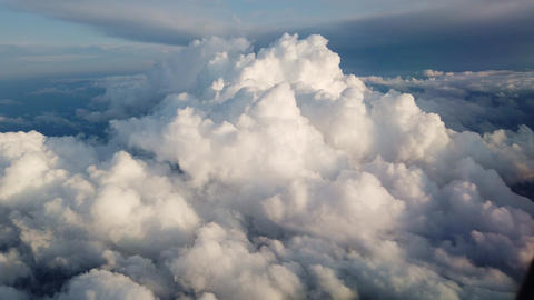 View of clouds and the solar sky from above from the plane. Clouds in the window Live Action