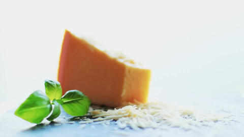 Parmesan cheese and basil leaf as shredded recipe ingredient, food and cooking Live Action