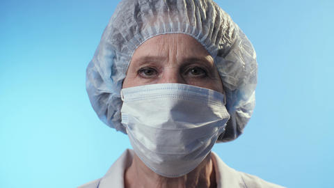 Sad physician takes off a surgical mask Live Action